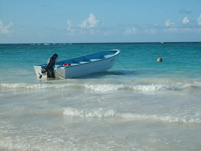 Boat anchored off an island in the Caribbean.